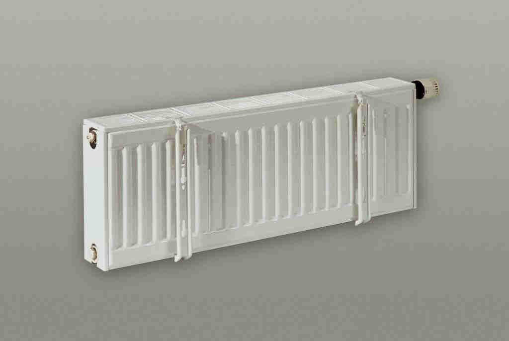 Крепление к стене стальных панельных радиаторов отопления