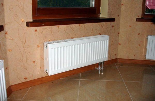 Стальной радиатор отопления с нижним подключением
