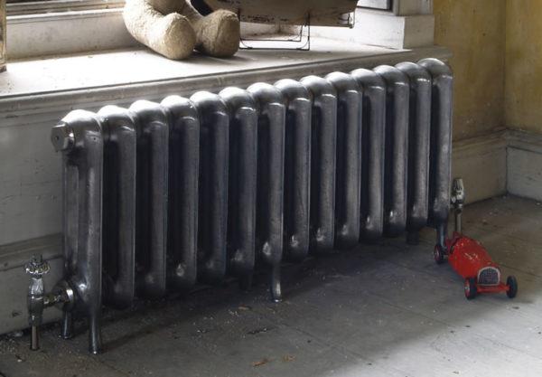 Установка чугунной батареи отопления